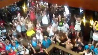 German girls dance in bikini on tables in a bar and flash their tits