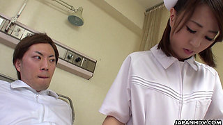 Japanese nurse Reina Wamatsu rubs dick uncensored