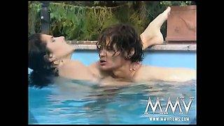 Hot brunette having erotic moist sex in the pool