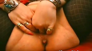 Busty MILF dildoing her pierced pussy