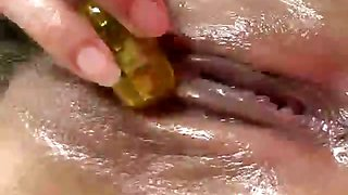 Busty Japanese babe Yuki Aida massaging her oiled body on