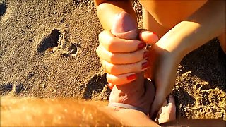 Busty babe rubs her snatch and blows a cock on the beach