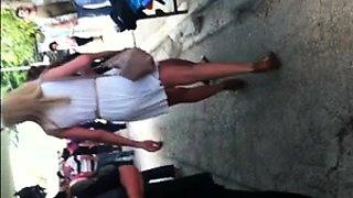 Stunning European teen with sexy legs voyeur upskirt outside