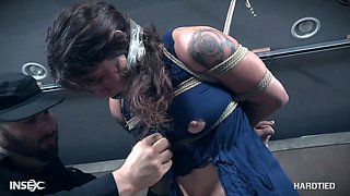 Bondage and suspended whore Tess Dagger gets her pussy punished