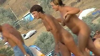 My beach voyeur video of horny milfs and teen girls playing in the water