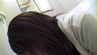 Japanese girls taking a pee in voyeur Japanese toilet video