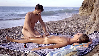 Charlotta gives a Tantric Beach Massage