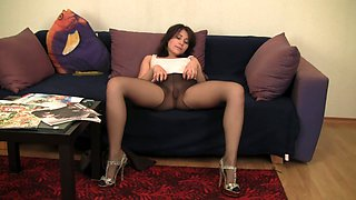 All horny and charming brunette babe in pantyhose takes various sexy poses