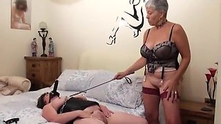busty granny mistress Savana plays with her slave