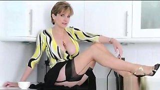 Busty British Dame Rubs Clit