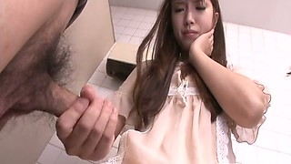 Enchanting Japanese girl gives handjob in a toilet