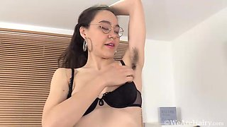 Rylee Mae strips naked by her white desk - WeAreHairy