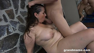 Voluptuous GILF dines on some fresh cock and she's got killer curves