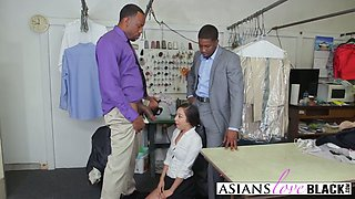 A slutty Asian tailor gets double penetrated by two horny black studs