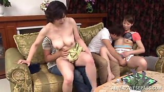 mature asians are fucked by horny guys in a foursome