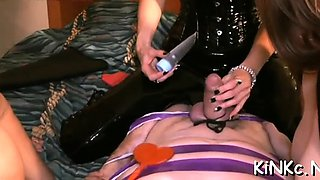 2 tractable slaves of wicked mistress in latex
