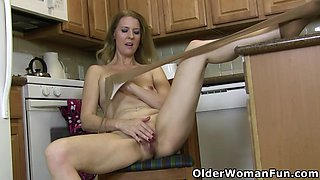 American milf Lacy gets naughty in the kitchen