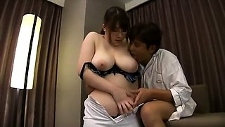 Huge titted Japanese milf enjoys boobs press and kissing