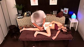 Slender Asian babe with sexy legs gets fucked by a masseur