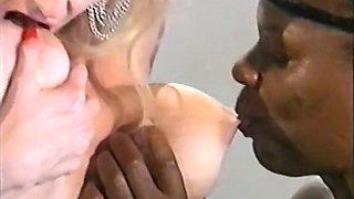 Blonde white lady feeding on a big black cock on her knees