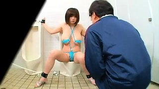 Stacked Oriental slave used by two guys in a public toilet