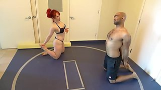 Red headed girl vs black guy wrestling