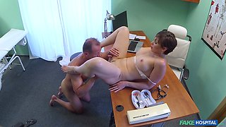 Mature redhead gets examined by her horny doctor