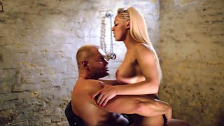 Blonde with large tits is sitting down on a large erection