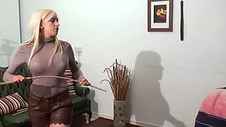 caning punishment by hot young blonde mistress in leather shorts