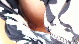 Japanese beauty shows her hard nipple in this spy cam video