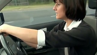 Horny housewife rubbing and fingering her pussy in a car