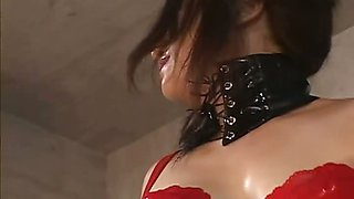 Horny Japanese MiLF in red latex with a strap on does some