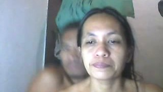Mature webcam couple poses all naked in their messy bedroom