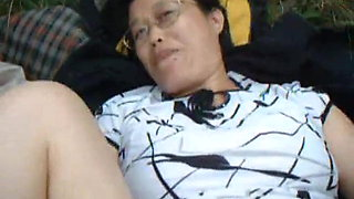 Chinese granny fucks in the wild