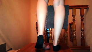 Amateur babe with sexy legs punishes a cock with her feet