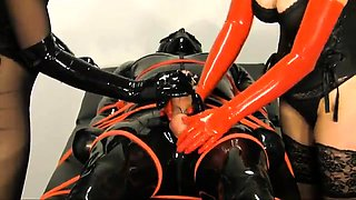 Horny slave in latex gets his hard cock teased and pleased