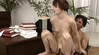 Redhead slim white girl bones in doggy style on the desk