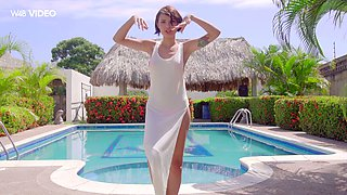 Beautiful babe Natali Leon is posing by the poolside