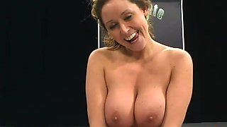 Busty bitch fucked with a strapon after wrestling