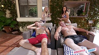Emma Starletto and Natalie Brooks are having a foursome next to the swimming pool and loving it
