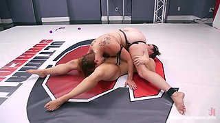 busty brunette getting dominated after losing wrestling match