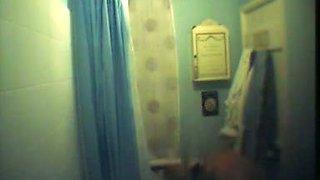 Big breasted blonde captured on a shower spy cam