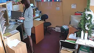 Hidden cam brunette in office