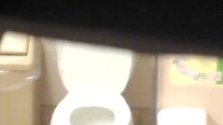 Brunette woman spied in public toilet pissing