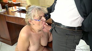 Whorish old housewife Viola Jones is sucking a dick of one young dude