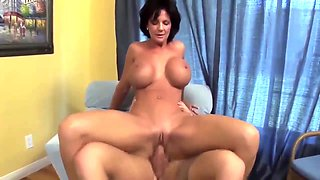 Busty Cougar Gets Young Cock