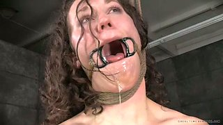 Nasty brunette girl gets her juicy muff toyed in the dungeon