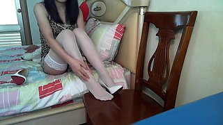 Webcam Showing Chinese Girl Massaging Sprained Ankle in Stockings