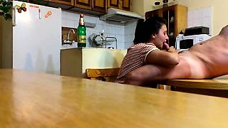 Amateur brunette wife gives a great blowjob in the kitchen