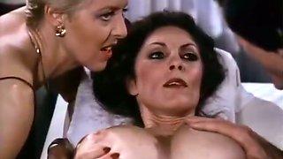 Hot brunette lady enjoys full body massage from a blonde babe